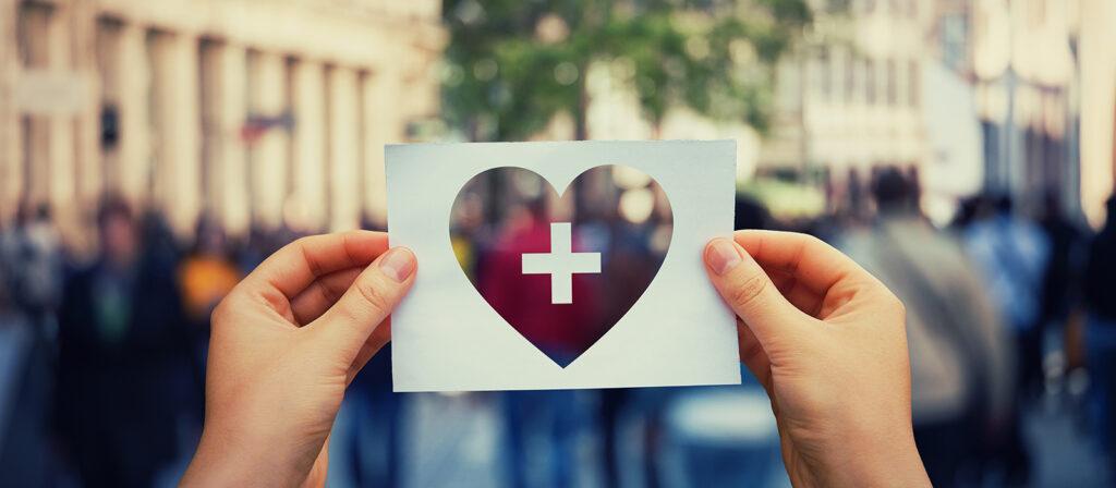 hands holding heart cutout