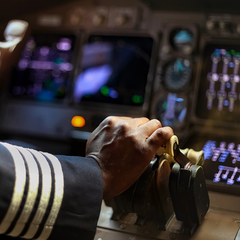 pilots hand on airplane control