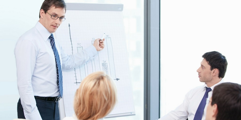 business man showing graph presentation