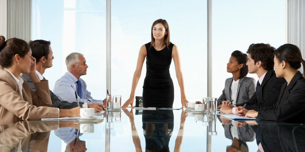 business lady at front of conference table